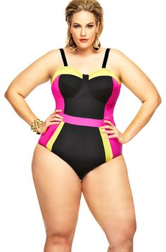 Strike a pose in this Monif C St Vincent Color Block One Piece Swimsuit.  The side color blocks create a slimming effect, while the neck and boy leg styling offer a sporty look.  The color block makes