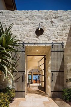 Beautiful barn doors are big in the world of decorating right now. Why not add c& p Beautiful barn doors are big in the world of decorating right now Why not add character to your living space with a rustic barn door this season p Design Exterior, Door Design, House Design, Wall Design, Stone Exterior, New Home Company, Mediterranean Decor, Stone Houses, Interior Barn Doors