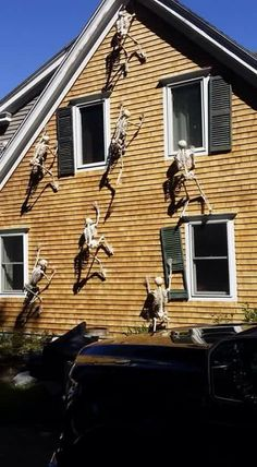 Halloween decorations with skeletons climbing up the side of the house. Genius!                                                                                                                                                     More