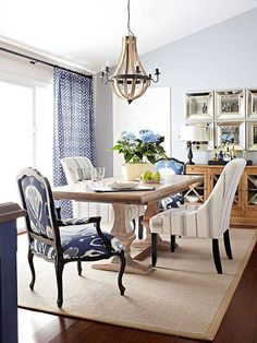 Add interest by mixing up upholstery fabrics on host & hostess chairs.