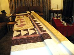 8' MDF boards (3) to roll quilt top, backing and batting onto-unroll in small sections and baste as you go...great tut...