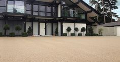 Clearstone Paving are the UK's quality resin bound driveway installer using a range of stones to achieve a quality surface. Resin Bound Gravel, Resin Bound Driveways, Gravel Drive, Driveway Paving, Pathways, Mansions, House Styles, Home, Decor