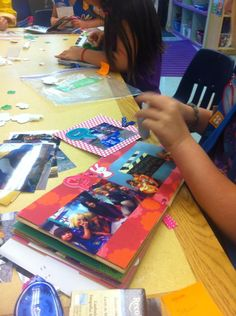 We made paperbag scrapbooks at the end of the year with pictures from all our doings throughout the year. We recycled cookie boxes for the cover and back page.
