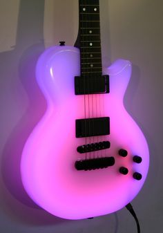 "Tonal Guitars | Rich Roland 1991 NEON Guitar  • ""Purple & Pink Hues (Bright & Light) . . .                     ""This one of a kind beauty is perfect for a colorful tune! It's pretty much the first neon guitar that didn't look like a beer sign. A Custom Carbon Graphite through the body and neck with EMG pickups, Schaeller hardware and a 3 channel light organ. Even Jimmy Hendrix would have seen new colors!""                                                                  Guitar…"