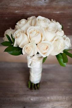 White-Rose-Wedding-Bouquet  Love this one too - about a dozen-18 roses with a little green accent and white ribbon.