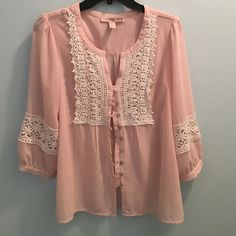 Pink and Lacy Forever 21 Shirt A beautiful shirt baby pink material, white lace, and silver buttons. It is slightly see through. I ship Monday-Friday, and I do a 20% bundle discount! I will take price listed or reasonable offer. :) Forever 21 Tops Blouses
