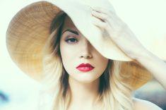 Lady in straw hat stock photo