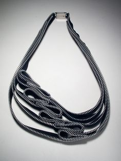These aren't beads, but zippers. Incredible. Also, maybe it'd work with St. Petersburgh stitch or herringbone?  Kate Cusack | Zipper Jewelry: Necklaces