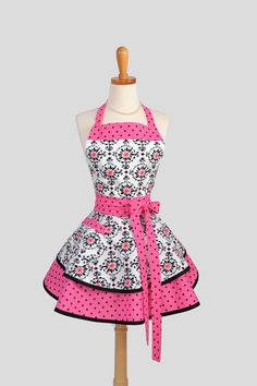 Ruffled Retro Apron ,Sexy Womens Apron in Shades of Pink and Black Floral and Dots Handmade Full Kitchen Apron. $45.00, via Etsy.