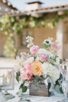 Flower Arrangements Inspiration: Loving this rustic centerpiece with cream, peach, and pink flowers! #roses #florals #centerpieces via Wedding Chicks Photography: Aaron Young Flowers: The Bloom of Time