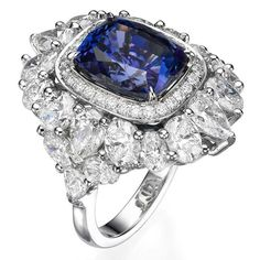 Russian Brand Yanushi Gioielli ~ Sparkling cocktail ring set with tanzanite surrounded by diamonds.