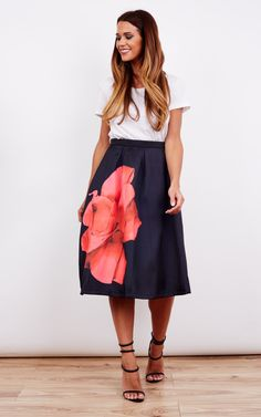 Show your feminine side this season with this beautiful A-Line Midi Skirt. The large floral pattern will attract all the right attention! Pair with a tucked in tee for a perfect casual day time look!