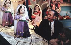 Mary Blair with Walt Disney checking out her final pieces for It's A Small World.