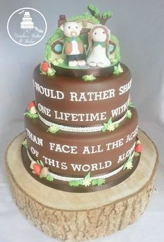 Two tier Lord of The Rings themed wedding cake with hand made hobbit bride and groom topper by Natalie's Cakes and Bakes