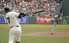 San Francisco Giants' Gregor Blanco swings and misses at a pitch thrown by San Diego Padres starting pitcher Ian Kennedy in the first inning...