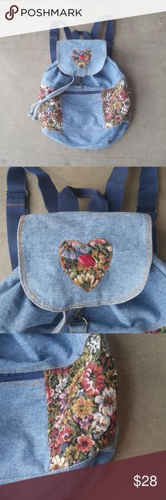 Vintage Denim Drawstring Floral Tapestry Backpack Denim backpack in excellent vintage condition! Medium blue denim with colorful floral tapestry details. Drawstring at top opening and gold metal hook. Adjustable straps. Perfect for hauling around your books to read in the park! No trades. No modeling. Make a reasonable offer. Thanks! Vintage Bags Backpacks
