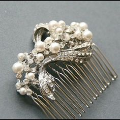 swavorski pearls & rhinestone hair comb With an elegant combination of pearls and crystals, this pretty vintage inspired hair comb would be the perfect compliment to your wedding day hair style!  Measurements of this hair comb :approx 2.5''x 2.25'' (These measurements includes the prongs of the comb)  - vintage collection - features vintage style brooch with countless crystal rhinestones. - will be made to order with CRYSTALLIZED™ - Swarovski Pearls. - attached to silver tone comb Etsy…