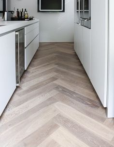 Chevron has been and still remains to be trendy so why not do a subtle version with the layout of your wood floors.