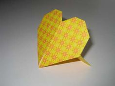 Origami stand-up hearts! So easy to make and perfect for the wedding...placecards, table numbers, random decorations...