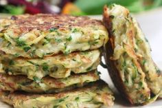 Zucchini Fritters                     Yield: Makes 12 frittersNutritional Information based on 1 fritter                    			   		 		 			 			 		 			INGREDIENTS450g Courgettes, grated 30g Freshly Grated Parmesan Cheese 2 eggs, beaten 4 tbsp Whole Wheat Flour Salt and Pepper to taste Pinch Chili Flakes