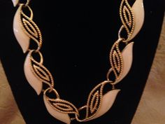 A personal favorite from my Etsy shop https://www.etsy.com/listing/509607443/trifari-tm-ivory-enamel-and-gold-tone