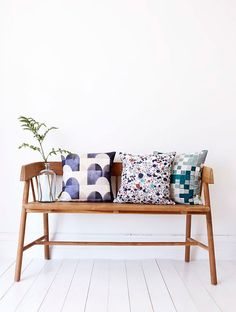 Minimal wood bench with pillows