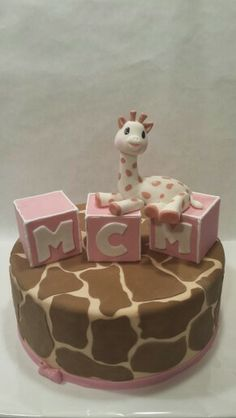 Sophie the giraffe first birthday.  Love the idea of doing giraffe spots on the light pink cake