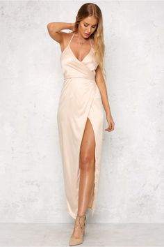 $65 HELLOMOLLY This gorgeous maxi dress has a draped, deep v-neckline with one thin halter strap. The panel crossing over the bust can be undone for ease of wear, whilst the skirt is also crossed creating a high leg split. Try pairing with delicate strappy stilettos!   Dress. Bodice lined. Cold hand wash only. Model is standard XS and is wearing XS. True to size. Slightly stretchy fabric. Polyester.
