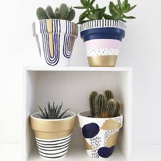A hand painted plant pot with deco-esque deep blue and gold design. A very fine home for your favourite plant. Measures high x top diameter. Sealed and treated for both water and UV protection and safe for planting. All pots have drainage holes.