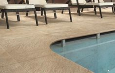 This sleek outdoor tile, from the AExtra20 collection, is the perfect match poolside. #HIT #Tile #Design