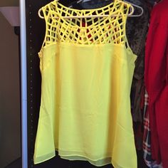 Crosshatch Yellow Top Very fun and flirty yellow top. Pretty cross hatch at the top. Shirt has tag that says XS. Ordered from plus size store, compared to a XL/1X. Tops Camisoles