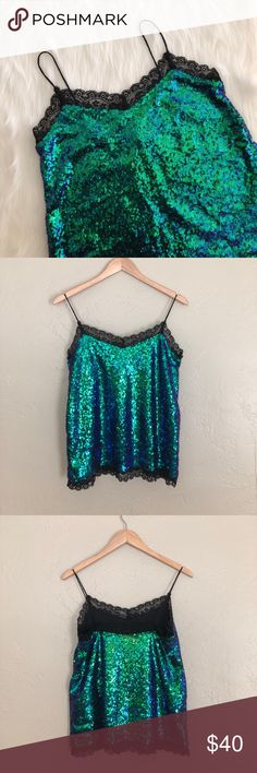 [motel] mermaid sequin lace camisole Worn only once in New Years! Super pretty cami by motel. Blue/green sequins with black lace. Runs large. Comes from a smoke-free home!! Price negotiable, within reason, so feel free to make an offer!! NO trades. NO 🅿️🅿️. LOWBALL OFFERS will NOT be tolerated! I love bundles though 🛍🛍🛍 ASOS Tops Camisoles