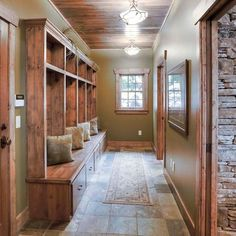 Good design example for mud room - tile on floor, wood built-ins, wood trim and doors. Mudroom Decor, Home, Sweet Home, Home Remodeling, New Homes, House, Mudroom Design, House Interior, Log Homes