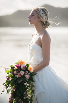 Elegant! @PninaTornai #vancouverislandweddings Hair Accessory by #thebridescloset #petalandkettle #kleinfeldcanada #petradishartiste #vanisleweddings #tofinoweddings  Beautiful photograph by @erinwallis !