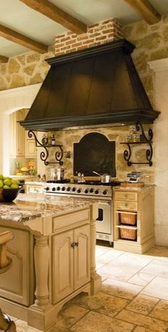 Love the stone cottage feel with wooden beam ceilings. Old range is beautiful. Like stonewash color of the cabinets with slightly darker but still neutral granite countertops.