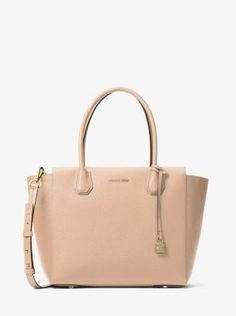 Crafted from pebbled leather, our polished Mercer satchel is a thoughtful update to a timeless silhouette. Its spacious interior is equipped to hold your laptop or tablet while a zippered compartment offers safe keeping for important items such as your keys and phone. Carry it by its elegant top handles or go hands-free with the removable shoulder strap.