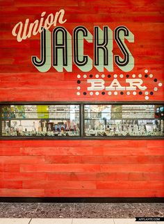 Restaurant and Bar Design Awards; The color of the wood along with the graphics is so fun and refreshing! Hotel Restaurant, Restaurant Design, Café Bistro, Jamie's Italian, Coffee Shop Bar, Bar Design Awards, Types Of Lettering, Wayfinding Signage, Hand Painted Signs