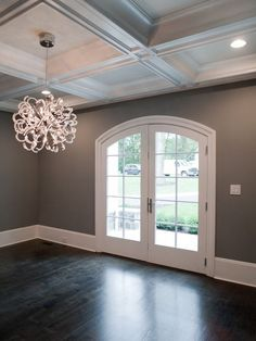 dark floors, gray walls, white trim.