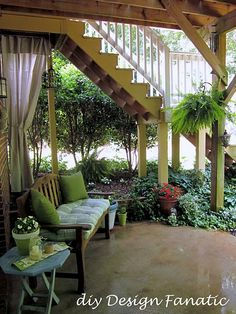 Under deck porch...Love the hanging lantern & plants.  Ivy for under the deck stairs?
