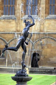 Tom Quad, Christchurch College, Oxford: a lead copy of Giovanni da Bologna's statue of Mercury was given to the college by a benefactor and placed on a pedestal by the famous architect Sir Edward Lutyens