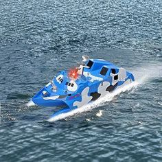 Ginzick Rc Remote Control Super Fun Missile Stealth Speed Boat (for adults and kids Great for Beginners} High Quality high performance blue and white Durable design for pools, small ponds, rivers and lakes with a Built-in water cooling system and Built-in alarm sound and light when battery is low