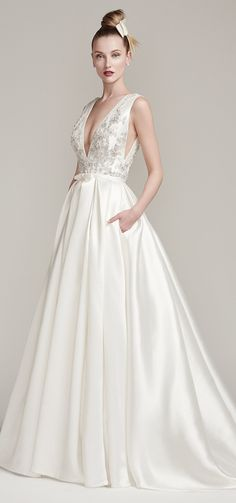 """Chic pockets! Just one of the reasons to love Sottero and Midgley's """"Margot"""". This elegant ball gown also features a gorgeous embroidered lace fitted V-neck bodice embellished with Swarovski crystals and beads. Stunning! Click image for details.  #bridal #wedding #weddingdress #lace #longsleeves #weddinggown #bridalgown #dreamgown #dreamdress #engaged #inspiration #weddinginspiration #weddingdresses #romantic #sotteroandmidgley #midgleybride"""