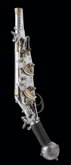 GERMAN WHEELLOCK BELT PISTOL DATED 1609, SIGNED VK, PROBABLY FOR VALENTIN KLETT OF SUHL with swamped barrel formed in four stages, overlaid with brass at the muzzle, median and the breech.
