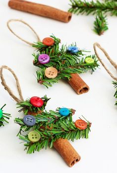 Supplies needed: 3″ Cinnamon Sticks 3/4″ Canadian Pine Garland Assorted Buttons Glue Gun...