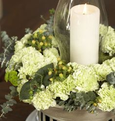 Hurricane glass centerpiece with carnations