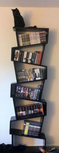 Switchback Bookshelf.. And the cat. I want the cat the most.