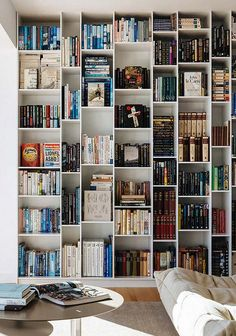 25 Modern Home Library Design Ideas That Stand Out A gorgeous modern home with a large asymmetrical bookcase that makes a statement and a comfy bean b Interior Architecture, Interior Design, Interior Styling, 1970s Architecture, Book Wall, Home Libraries, Built In Bookcase, Bookcase Styling, Dream Decor