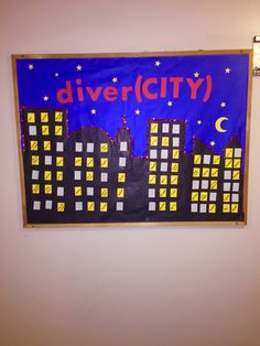 """Diversity """"diver(CITY)"""" RA bulletin board - each window contains a word about something that makes people diverse.   IUPUI Resident Assistant Board"""
