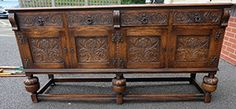 Top 25 Highest Selling Lots - Lot 54 - Reproduction Carved Oak four door sideboard - Sold for £200.00