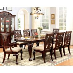 Delight in the formalities and start hosting grandiose dinner parties with the Ranfort Dining Set. This 9-piece set features warm cherry finishes to accentuate the wood construction and inviting design.